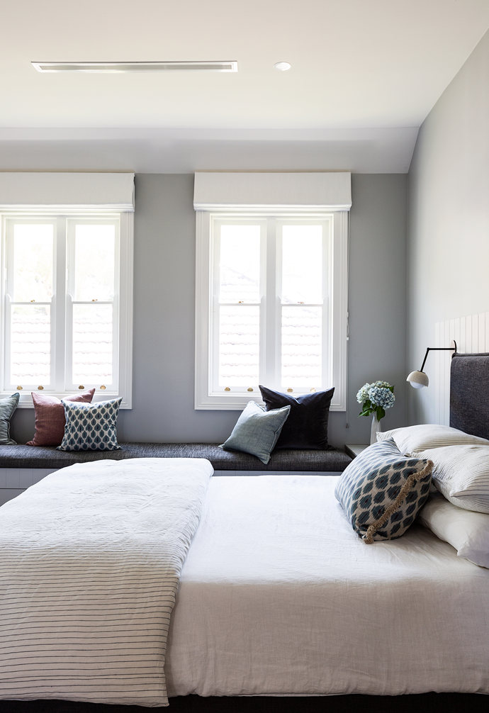 The soothing main bedroom has been painted in Dulux Tranquil Retreat, with 'Tussore' wool carpet in Madder from Bremworth underfoot. The Create Estate bed frame and the window-seat upholstery have been finished with Westbury Textiles fabrics for an elegant touch.