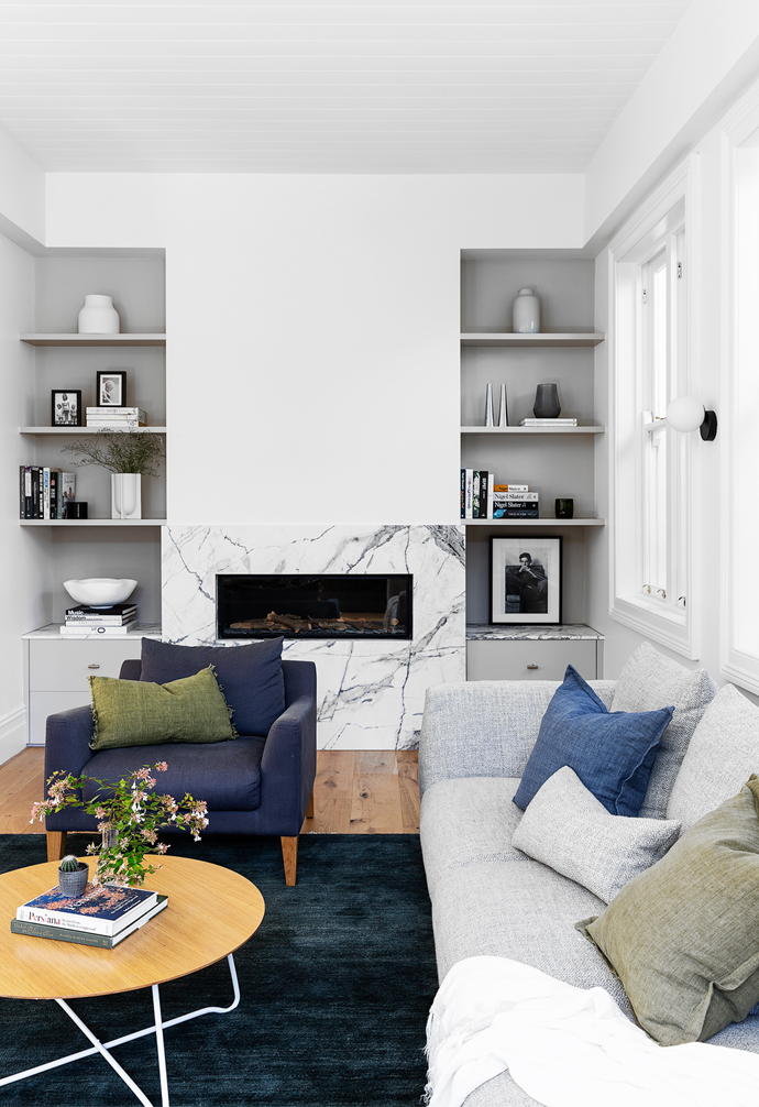 """""""Everybody tried to make the back part of the home totally open plan, but I said no because open-plan spaces are always so noisy,"""" says Fleur. Fleur chose the large tonal abstract artwork by Libby Mewing here for its soothing colour palette, while the framed photo of Al Pacino was a gift from former workmates."""