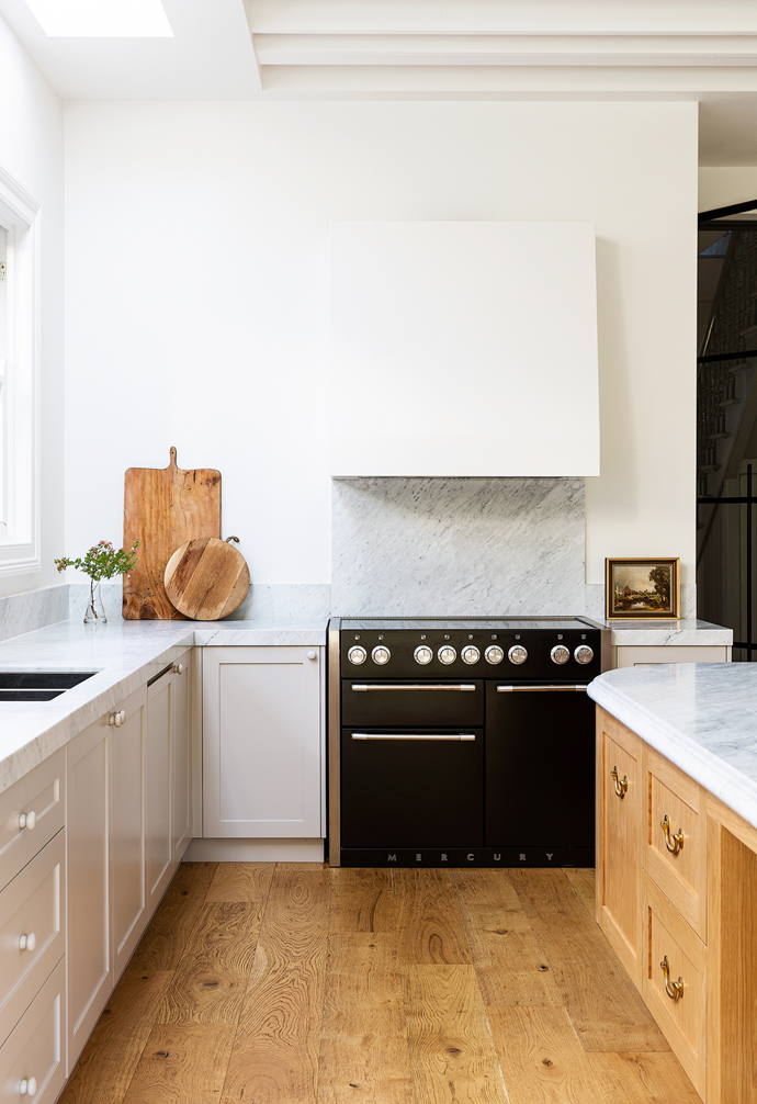 Daylight in the kitchen is enhanced by a skylight and walls in Dulux Natural White.