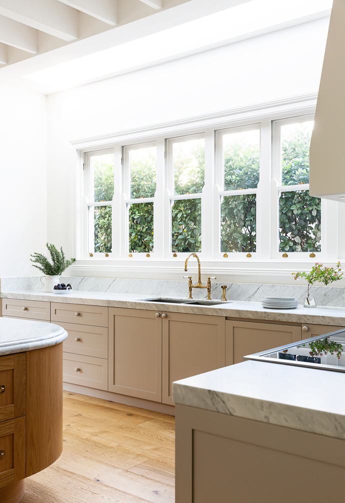 """A skylight and sash windows bathe the space in light. [Shaker-style cabinets](https://www.homestolove.com.au/shaker-style-kitchens-21500