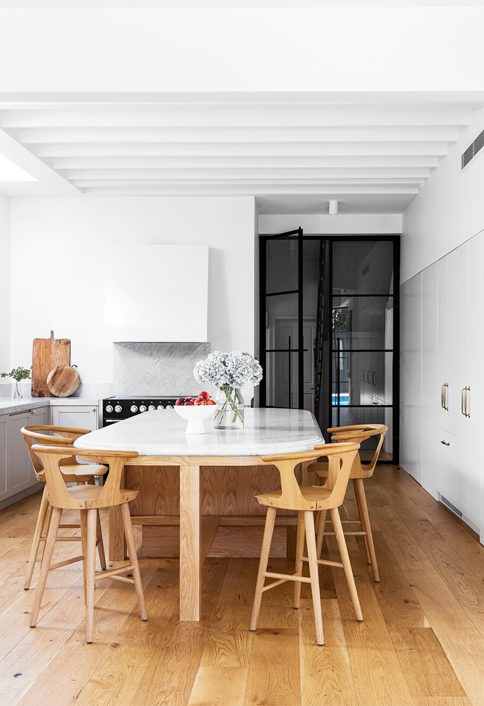 CDK Stone supplied the 'Bianco Carrara' honed marble for the benchtops and splashback, and oak veneer was chosen for the island base to match the oak floorboards from Woodos seen throughout the ground floor.