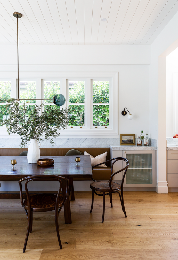 """Daughter Grace at the [dining banquette](https://www.homestolove.com.au/banquette-seating-ideas-21101