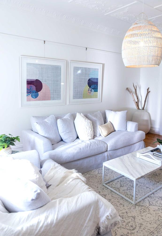 In this living area in the Casey Street home, a white rattan pendant light adds a coastal cool aesthetic.