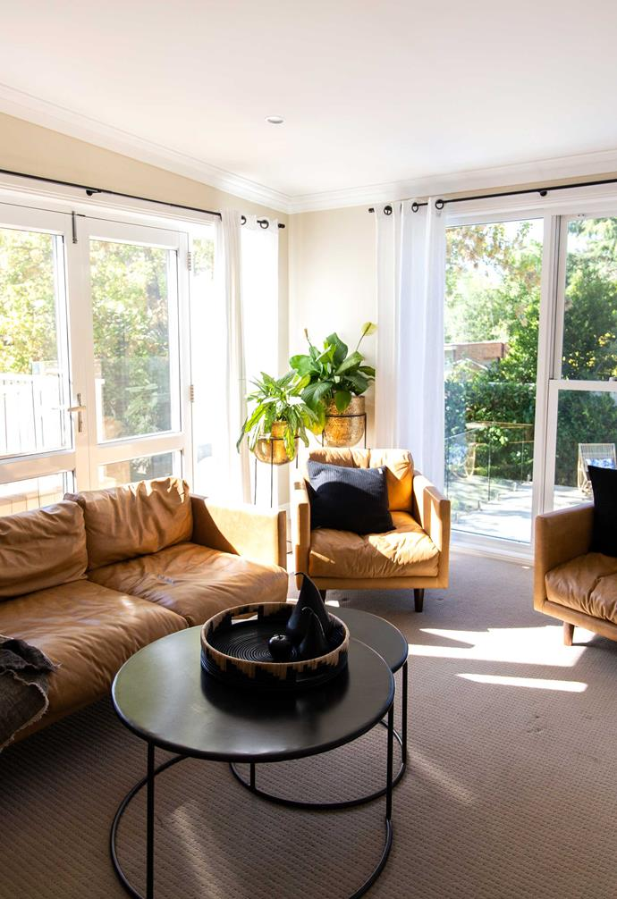 Tan leather sofas create a cosy living area.