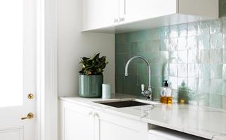 green tile splash-back in laundry