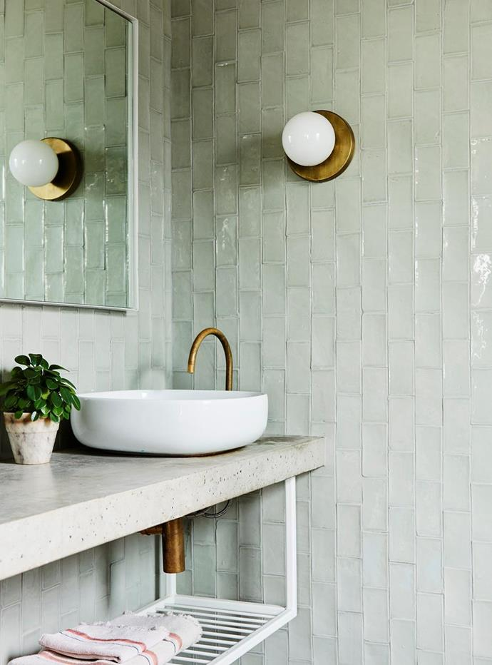 """Pale green tiles in the bathroom echo those in the kitchen of [Artist Prudence Oliveri's bold and beautiful Jan Juc home](https://www.homestolove.com.au/prudence-olivieri-home-21346