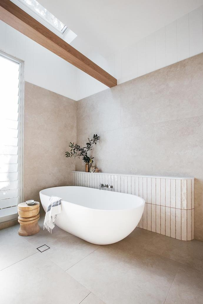 """Curving the tiled feature wall was a clever way to subtly incorporate the rounded theme that flows throughout the rest of [Kyal and Kara's Mediterranean-style home](https://www.homestolove.com.au/kyal-and-kara-new-home-21483
