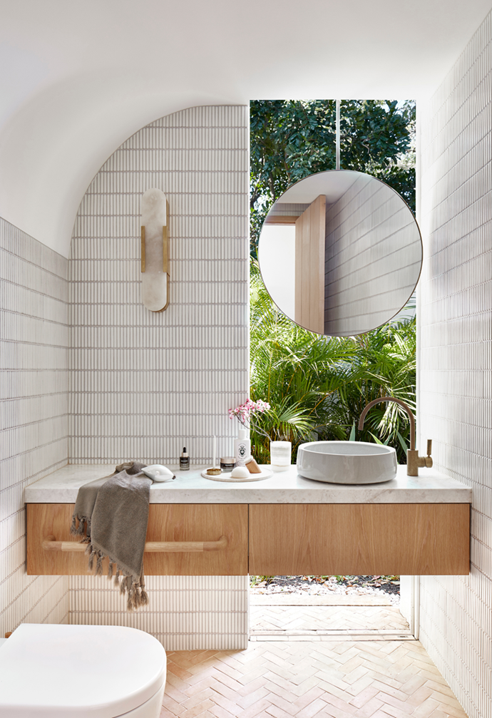 """Finger tiles adorn the curved walls of this contemporary bathroom in a [cool and calm coastal home in Palm Beach](https://www.homestolove.com.au/casual-christmas-decorating-ideas-22082