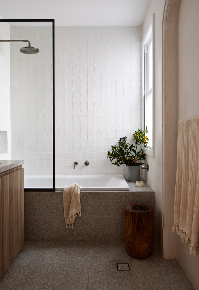 """Coloured tiles add interest to the muted scheme, while the oak vanity and Topaz sustainable timber stool contribute texture in the bathroom of this [interior designer's beautifully minimal Victorian terrace](https://www.homestolove.com.au/minimal-victorian-terrace-sydney-21869