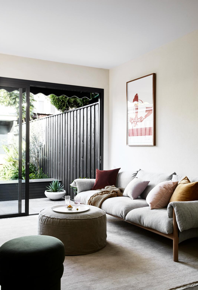 """An open-plan living and dining space opens out to the courtyard in this [stylish Victorian terrace](https://www.homestolove.com.au/minimal-victorian-terrace-sydney-21869