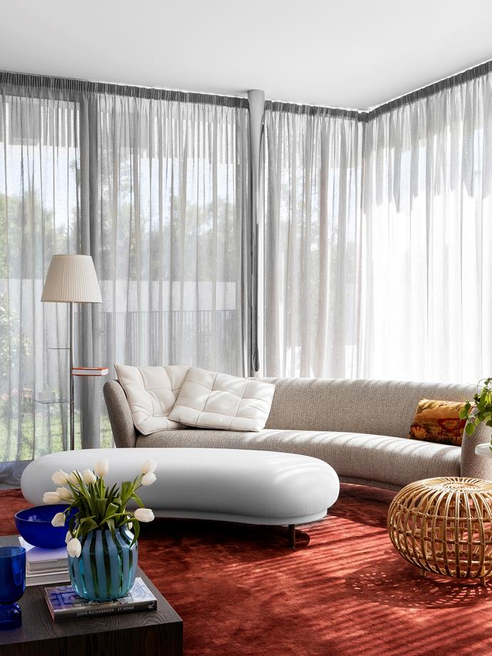 'Dandy' sofa and ottoman by Massproductions from District. Sika Design rattan ottoman by Franco Albini from Domo. Custom art silk and wool blend rug from The Rug Establishment. 'Plateau' side table from Blu Dot. Custom XL cushions on the sofa by Brem Perera. Hay vases from Cult.
