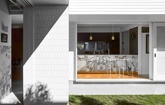 Gloss white tiles complement slabs of dolomite from SNB Stone.