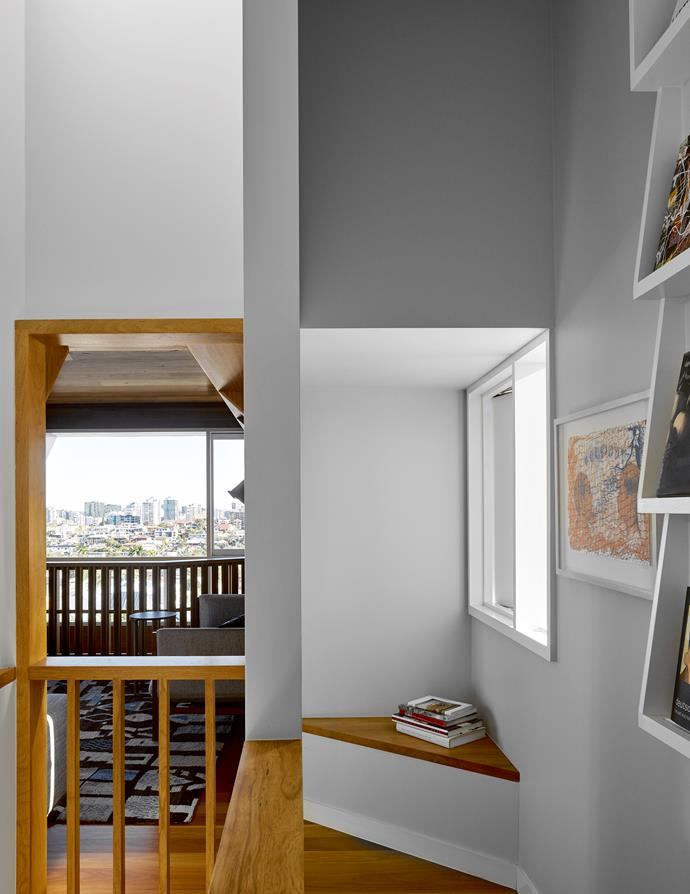 Seating nooks are a response to the home's many angles. Artwork by Judy Watson.