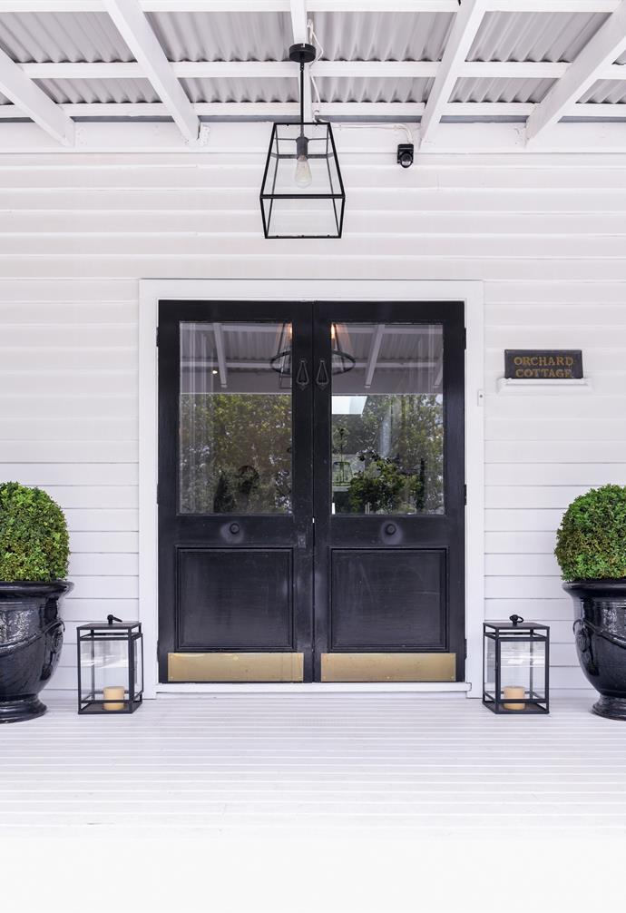 A grand monochrome front entrance welcomes guests on the front verandah.