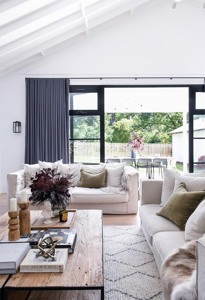 """Homeowner Carol was determined to combine comfort with a tailored look in her Blue Mountains cottage. """"I truly sat on a thousand sofas before choosing these,"""" Carol says of the 'Hampton' sofas from MCM House. """"They feel plush, but are still so functional and well made."""" A pair of MCM House [coffee tables](https://www.homestolove.com.au/10-of-the-best-coffee-tables-13248