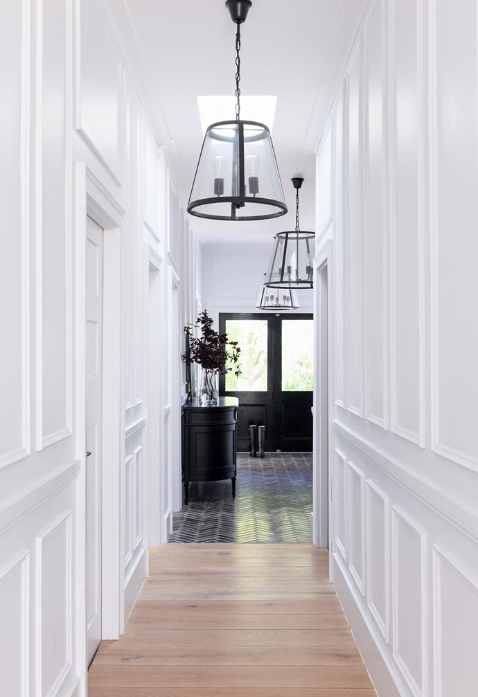 A peek of the home's stunning extension can be glimpsed down the hall.