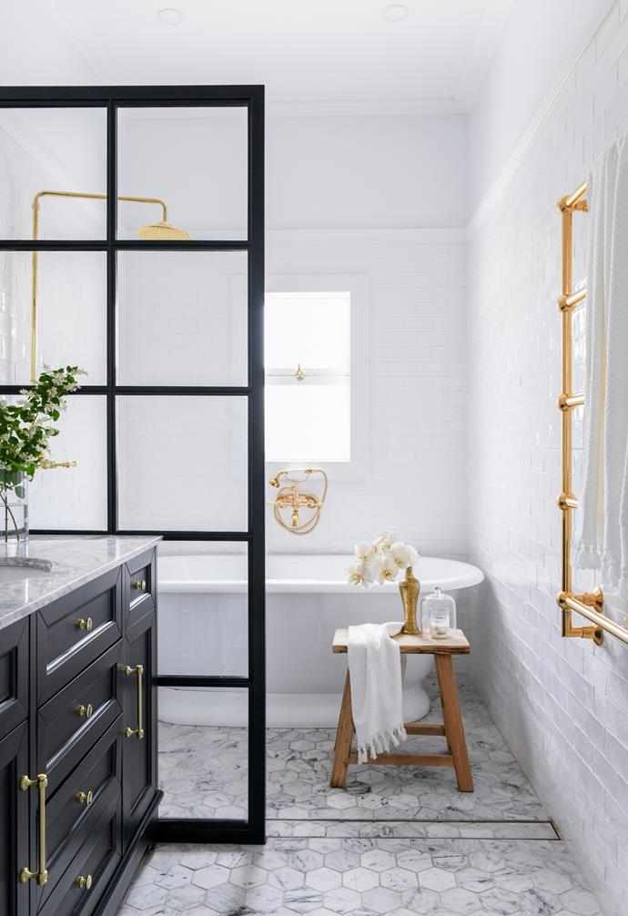 Carrara marble mosaics and Osso subway tiles, both from Di Lorenzo Tiles, form a fresh setting for the Elwick bathtub by Victoria + Albert and gold fittings by The English Tapware Company. The steel-framed shower screen by Cordony Constructions and the marble-topped black vanity from Vanity By Design add bold contrast.