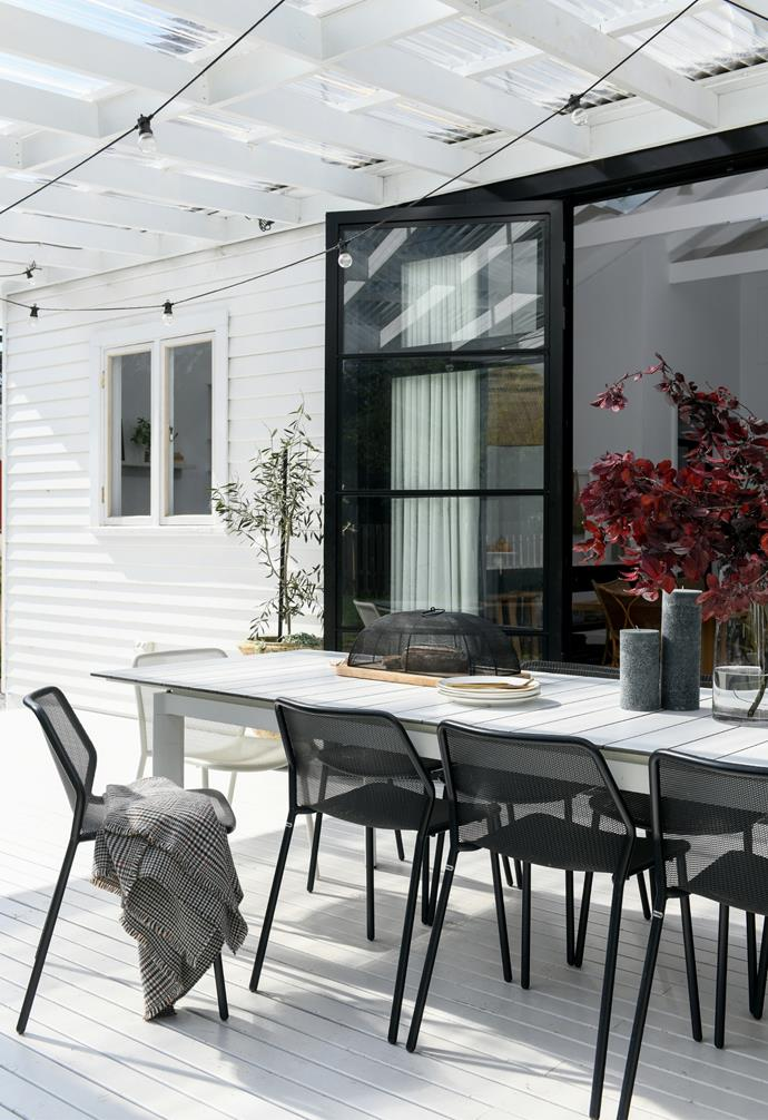"""""""We are a Lebanese family, so we are all about the food and drink!"""" Carol says with a laugh. When the barbecue is fired up, everyone gathers around the Porto dining table and Darwin chairs from Eco Outdoors."""