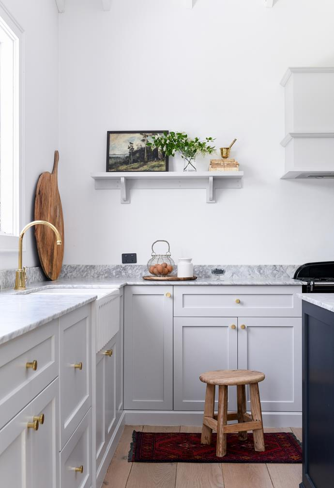 The grey palette continues with cabinetry in Dulux Tranquil Retreat, while gold handles, tapware and statement mesh panels  inset into the cabinet doors, all from The English Tapware Company, enhance the sense of refined luxe.