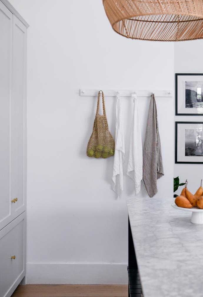 """""""I didn't want it to look like a full kitchen,"""" Carol says. Carrara marble from Harmony Stone Gallery is part of the modern classic look."""