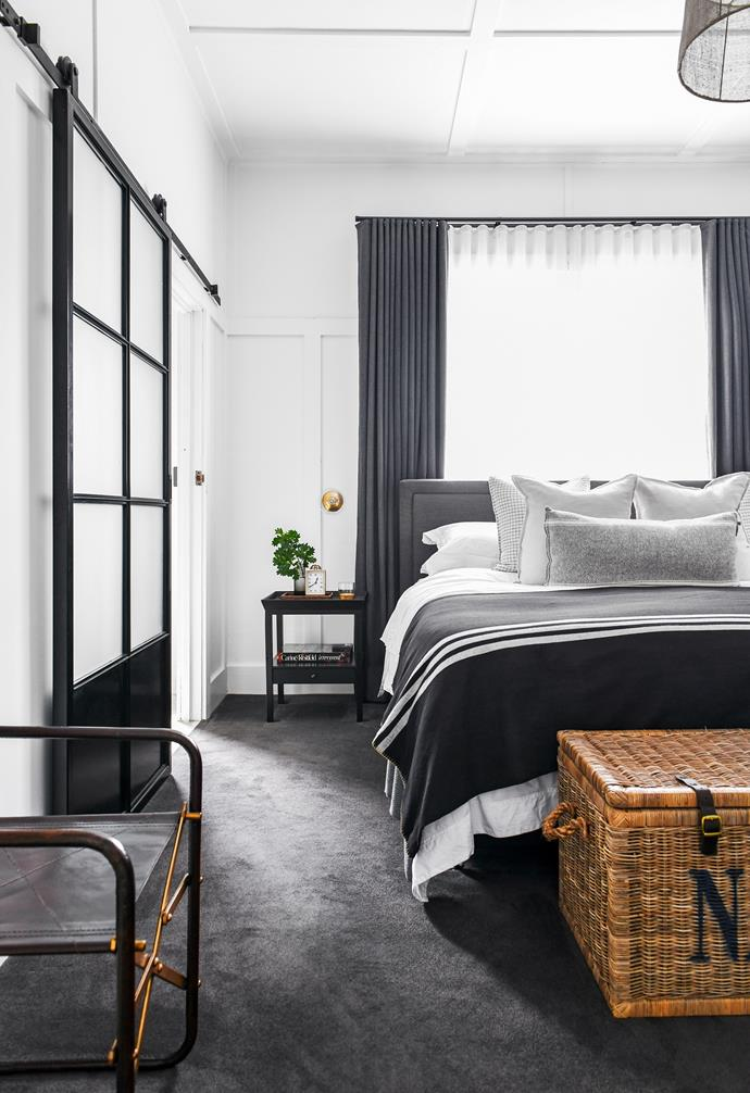"""Inspired by one of her favourite designers, Carol has decorated this space in the style of Ralph Lauren. """"It's a room of luxury, with its king bed and the original fireplace,"""" says Carol. A trunk from Hamptons Style sits at the foot of a bed from Suzie Anderson Home, flanked by bedside tables from Coco Republic."""
