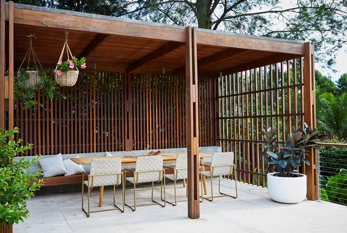 Two pergolas, made from recycled spotted gum, are built on the suspended concrete terraces at the rear of the homes; the flooring is travertine pavers.
