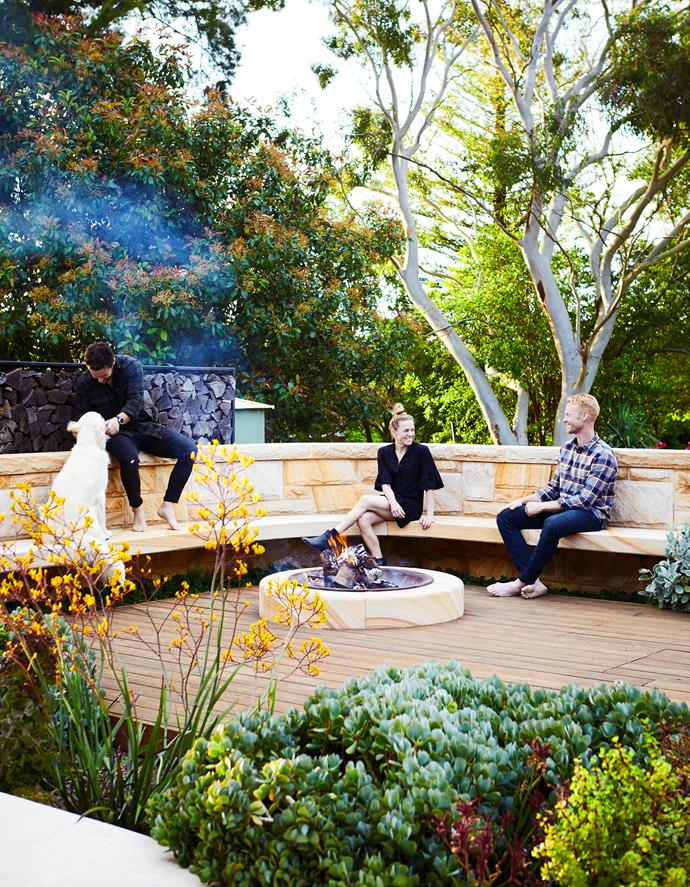 After two years of planning and construction, the team from Outdoor Establishments (from left) Trystan Graham, Haley Downes and Matt Hook enjoy the fruits of their labour, sitting around the firepit built from Sydney sandstone. Encircling the area are silvery jade plants (Crassula 'Bluebird') and Kalanchoe 'Silver Spoons' with kangaroo paw (Anigozanthos) in mixed colours.