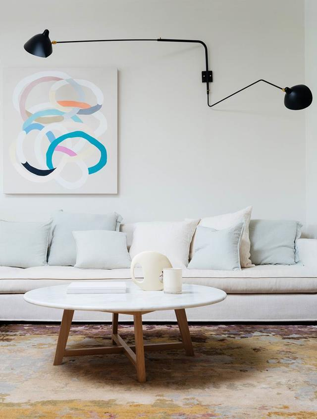 A well-chosen sofa can be a forever piece for your home. White linens or warmer woven fabrics keep your living room feeling fresh and bright all year-round. Photo: Felix Forest   Stylist Megan Morton