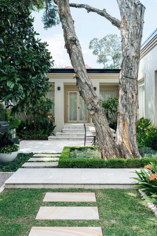 """The owners wanted a balance of lawn, plantings and tiled surfaces, in a design that respected the architecture of their heritage-listed [harbourside home](https://www.homestolove.com.au/backyard-garden-designed-for-outdoor-living-19155