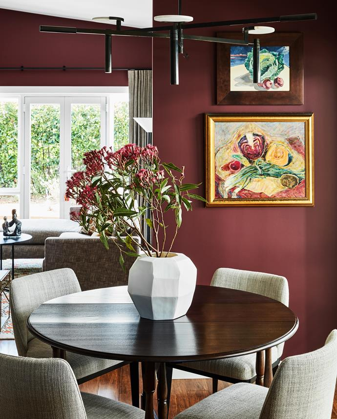 A gate-leg dining table that once belonged to Johnathon's grandparents takes pride of place in the dining room. Vase, Conley & Co. Dining chairs, Colby Furniture. Kelly Wearstler 'Melange' chandelier, available from Bloomingdales Lighting. Artworks by Chris Lewis (top) and Maximilian Feuerring.