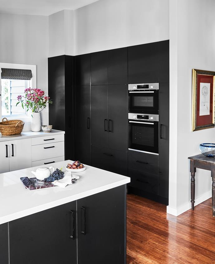 The kitchen features Polytec 'Venette' joinery with handles from Kethy. Smartstone benchtops in Gelsomino. Walls painted Dulux Unforgettable. Bosch microwave and oven; Fisher & Paykel integrated fridge. The artwork is a Salvador Dali art print.