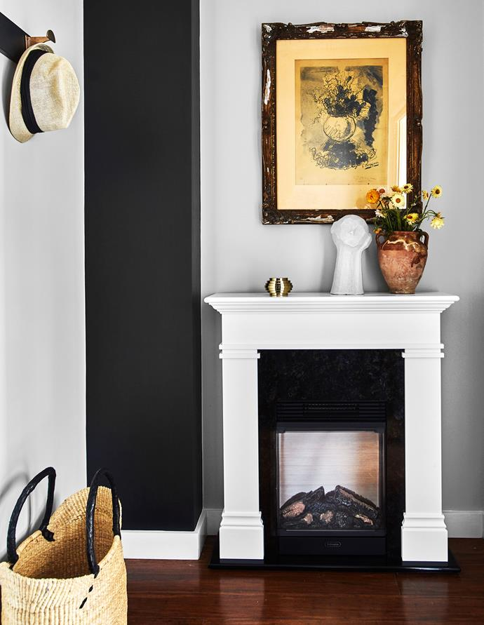 A Dimplex 'Taylor Firesuite' fireplace has given an awkward alcove new purpose. Antique etching. Ziggurat box, Greg Natale. Sculpture by Kristiina Engelin. Vase, Water Tiger. Market basket, Casa Catinella.