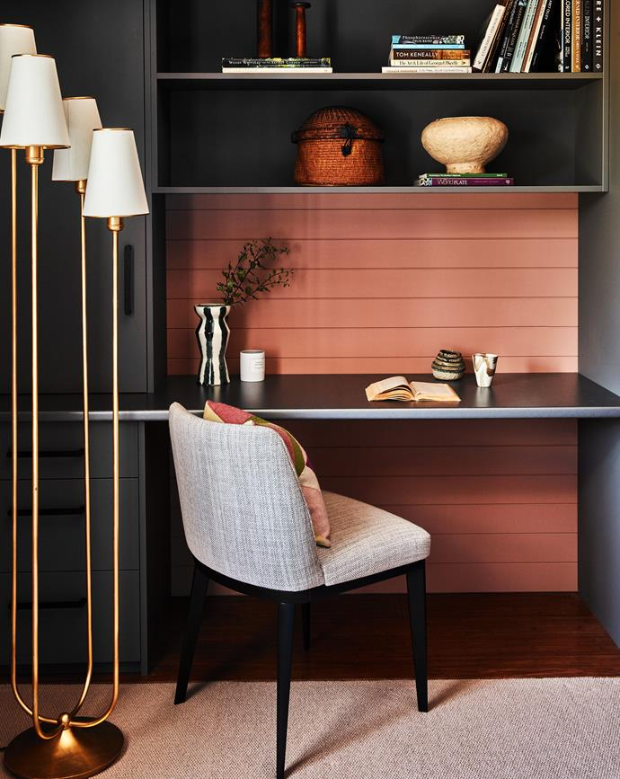 One guestroom's over-generous wardrobe was divided into a wardrobe and study nook. Custom joinery by Lynne Bradley. Stella side chair, Colby Furniture. Montreuil floor lamp, Bloomingdales Lighting. EasyGroove panelling, Easycraft. Panelling painted Dulux Turkish Bath