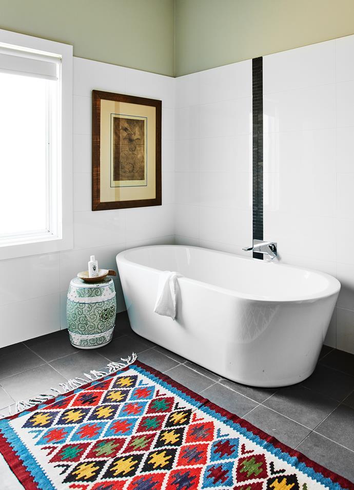 Artwork by Robert Juniper. Ceramic drum stool, Orient House. Bath, Reece. Existing tiles.