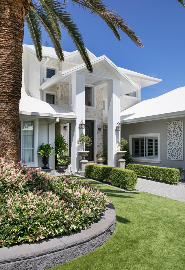 """A [grand Hamptons style home](https://www.homestolove.com.au/riverfront-hamptons-home-gold-coast-22488 target=""""_blank"""") with plenty of street appeal on the Gold Coast."""