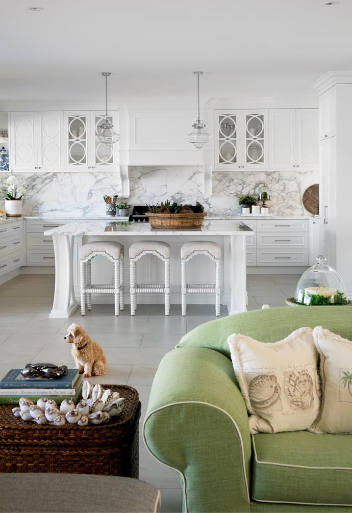 """The living room flows effortlessly to the [luxurious white kitchen](https://www.homestolove.com.au/best-white-kitchens-17040 target=""""_blank"""")."""