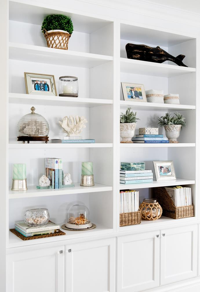 """Handcrafted joinery such as this floor-to-ceiling shelving in Michelle's office provides abundant storage and space to showcase curated collections. """"I use the shelving to display vignettes with pieces I've picked up on my travels, along with pieces of coral and often-referenced interiors books,"""" says Michelle."""