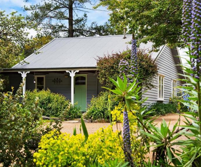 Dark grey cottage in Hepburn Springs with blue front door