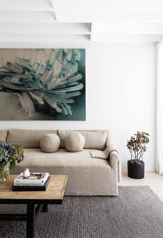 """**Living area** An artwork with a lot of movement enhances this rear space's neutral palette. Custom sofa, [Tow And Line](https://www.towandline.com/