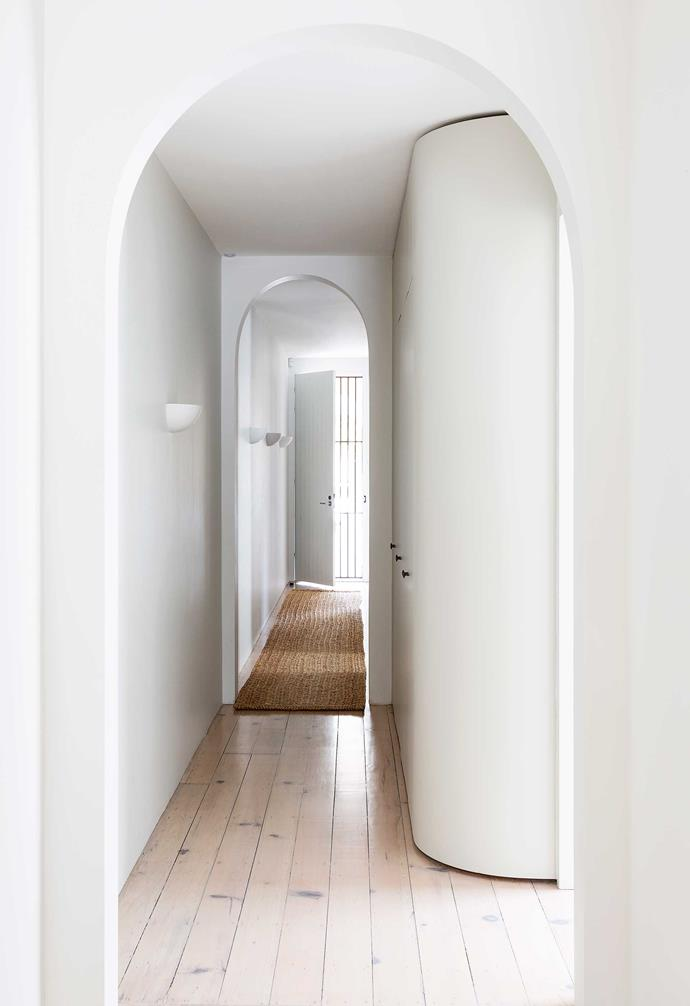 """**Hallway** Rounding off the storage cupboard was a stroke of genius as it opens up the passage to the living areas. The Contemporary Plaster LED wall lights are from [Lighting Collective](https://lightingcollective.com.au/