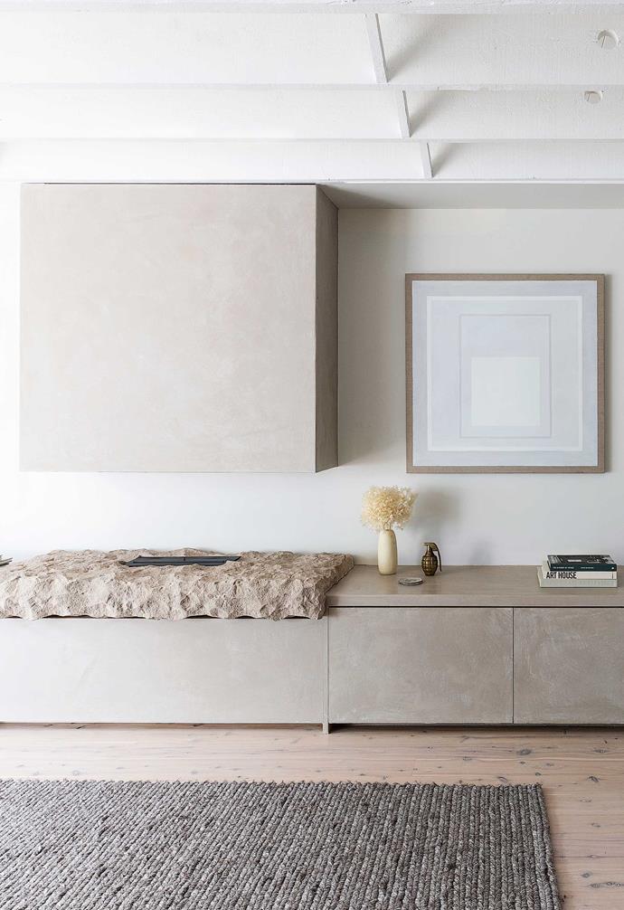 "**Living area** Chloe designed the cabinetry with a finish by [Venetian Plaster Sydney](https://venetianplaster.sydney/|target=""_blank""|rel=""nofollow""). [iSpace Solutions](https://www.ispacesolutions.com.au/|target=""_blank""|rel=""nofollow"") built it, and the sandstone piece under the [EcoSmart](https://ecosmartfire.com.au/|target=""_blank""|rel=""nofollow"") fire is from [Gather Co](https://gatherco.com.au/|target=""_blank""|rel=""nofollow""). Wall colour, [Dulux](https://www.dulux.com.au/|target=""_blank""|rel=""nofollow"") White Exchange Half. Artwork by Danica Firulovic."