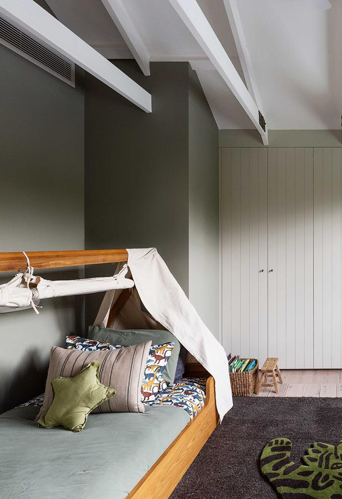 """**Oscar's room** The niche structure created by the roofline makes a great spot for the Hideout canopy bed from [Freedom](https://www.freedom.com.au/