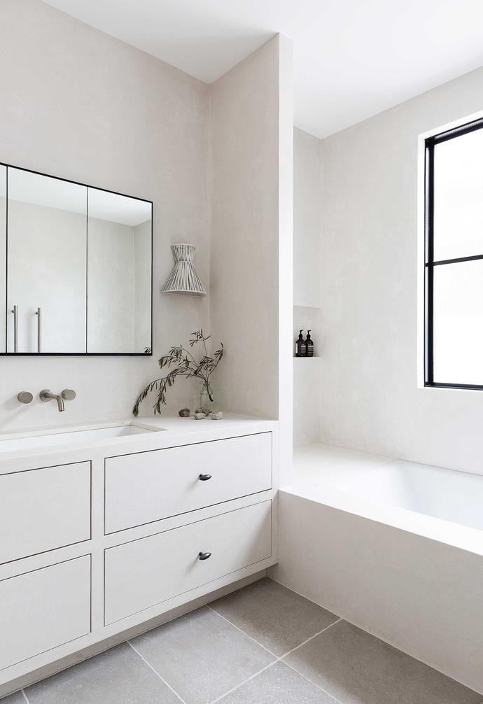 """**Family bathroom** Complementing the Tadelakt wall finish are white surfaces, grey tiles and black details. Custom mirror, [iSpace Solutions](https://www.ispacesolutions.com.au/