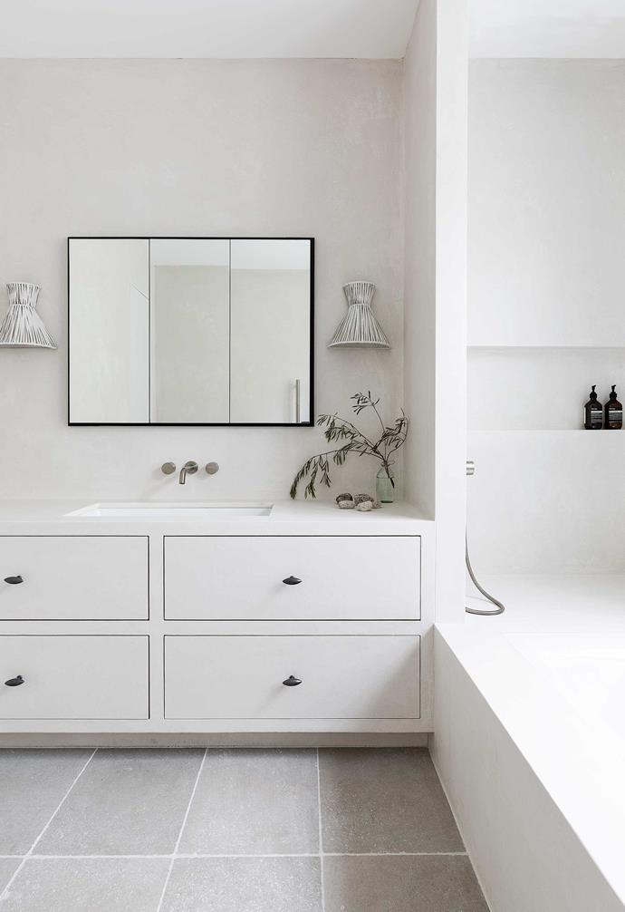**Bathroom** Chloe practiced what she preaches in the main bathroom of her family's Federation home, pairing a rugged Tadelakt plaster wall finish with pristine white surfaces and shadowy black detail.