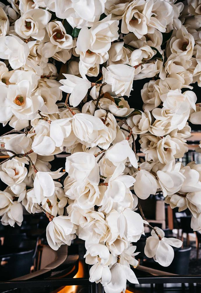 White flowers are beautifully clustered together to create a dramatic sculptural feature Black Bar & Grill.