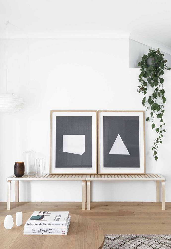 """**Living area** The Artek '153A Bench' from [Anibou](https://anibou.com.au/ target=""""_blank"""" rel=""""nofollow"""") is the perfect spot to prop up a pair of James Turrell prints."""