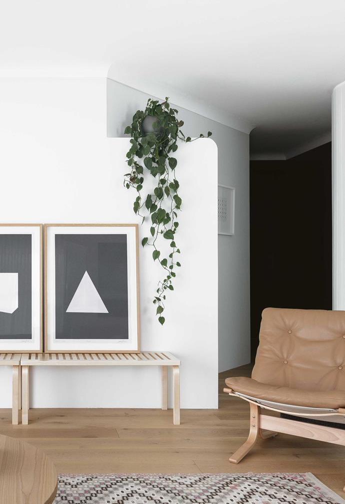 **Living area** The Noguchi 'Akari' pendant light is another source of light. In the background, a hit of charcoal in the hallway and a curved blade wall work to block out the bedroom area.
