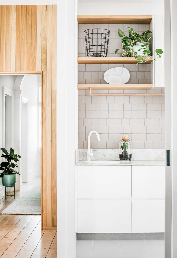 """Just off the kitchen of a Melbourne home, this laundry has made it possible for the owner to put through a load of washing while cooking dinner. But despite being meticulously planned, there was a glitch in the build and necessity became the mother of invention for the project's designer, [Lena Bruno](https://bybruno.com.au/