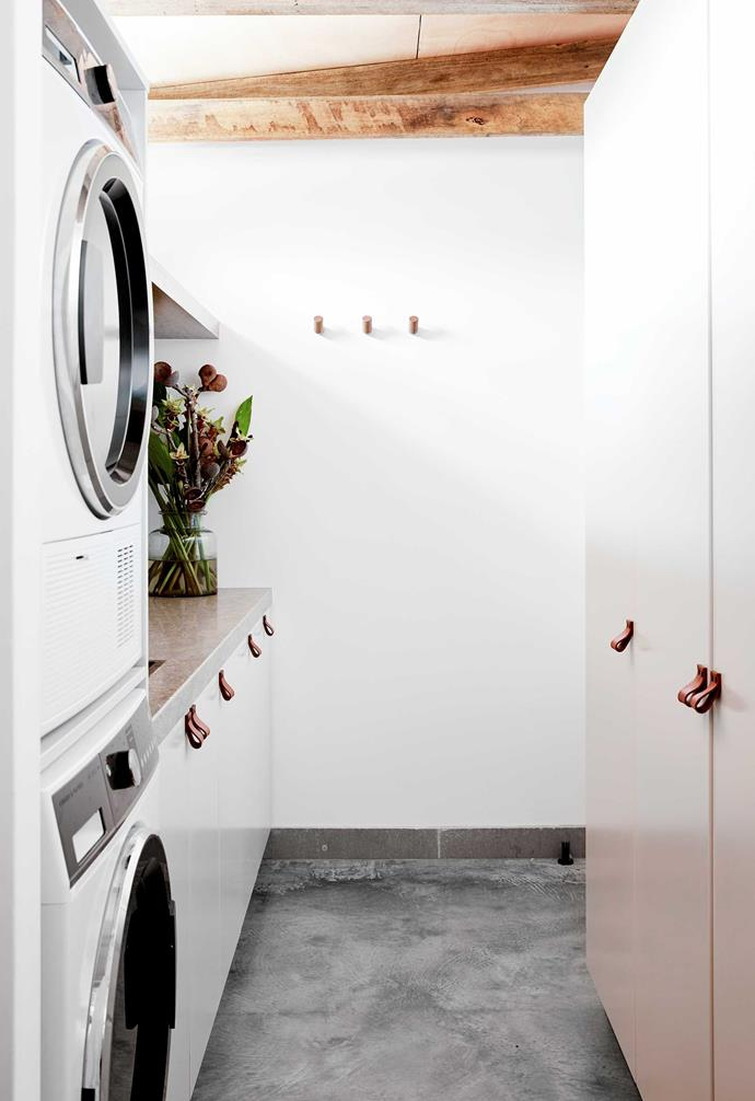 """Hidden behind the beautiful doors of this sleek laundry – part of a home in the Byron Bay hinterland – is a huge linen cupboard and lots of storage. Also featured are baskets for sorting washing and a set of floating shelves for displaying treasures. <br><br>""""The mix of materials is definitely the hero design element,"""" says [The Designory](http://www.the-designory.com.au/