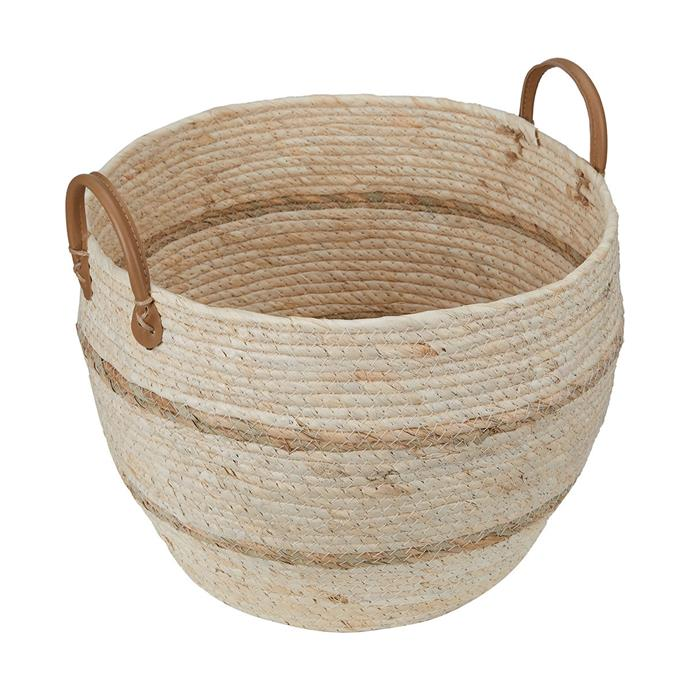 """Store your extra throws and blankets in this [Tan Stripe Basket](https://www.kmart.com.au/product/tan-stripe-basket/3503801